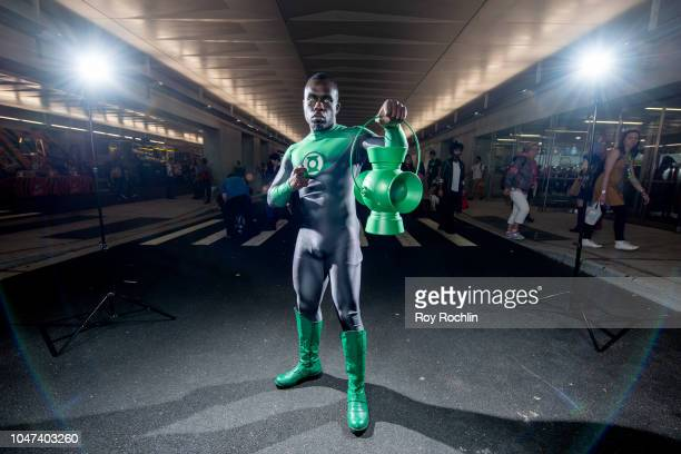 A fan cosplays as Green Lantern form the DC Universe during the 2018 New York ComicCon at Javits Center on October 7 2018 in New York City
