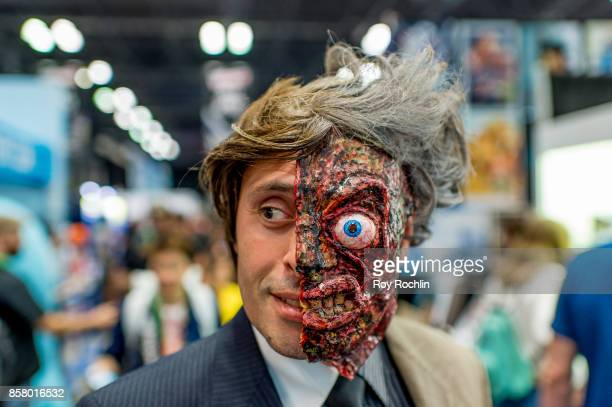 Fan cosplays as Harvey Two Face during 2017 New York Comic Con - Day 1 on October 5, 2017 in New York City.