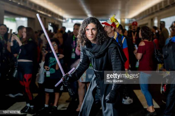 A fan cosplays as Kylo Ren from Star Wars during the 2018 New York ComicCon at Javits Center on October 7 2018 in New York City