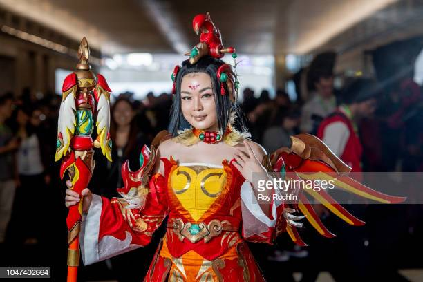 A fan cosplays as Mercy from Overwatch during the 2018 New York ComicCon at Javits Center on October 7 2018 in New York City