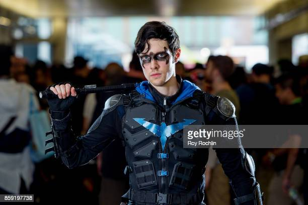 A fan cosplays as Nightwing from Batman during the 2017 New York Comic Con Day 4 on October 8 2017 in New York City
