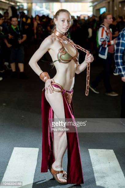 A fan cosplays as Princess Leia form Star Wars during the 2018 New York Comic Con at Javits Center on October 5 2018 in New York City