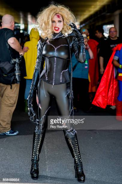 A fan cosplays as Selina Kyle aka Catwoman from Batman and the DC universe during 2017 New York Comic Con Day 2 on October 6 2017 in New York City