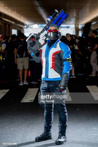 A fan cosplays as Soldier 76 from Overwatch during the 2018 New York ComicCon at Javits Center on October 7 2018 in New York City