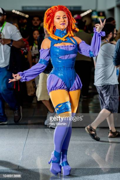 A fan cosplays as Starfire from the DC Universe during the 2018 New York Comic Con at Javits Center on October 6 2018 in New York City