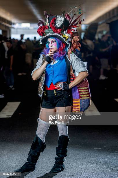 A fan cosplays as The Mad Hatter from Alice's Adventures in Wonderland and Alice in Wonderland during the 2018 New York ComicCon at Javits Center on...