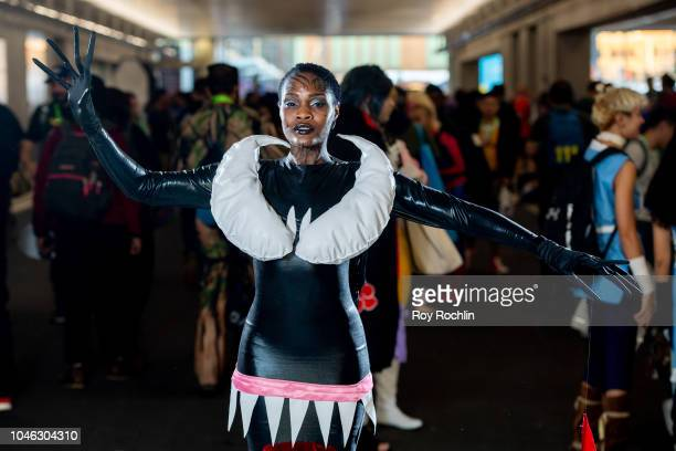 Fan cosplays as Venom form the Marvel Universe during the 2018 New York Comic Con at Javits Center on October 5, 2018 in New York City.