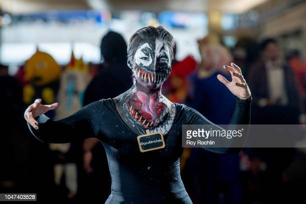 Fan cosplays as Venom from the Marvel Universe during the 2018 New York Comic-Con at Javits Center on October 7, 2018 in New York City.