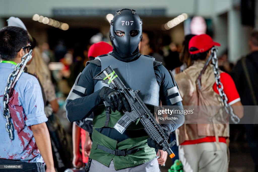 A fan cosplays as Vigil from Rainbow Six Siege during the