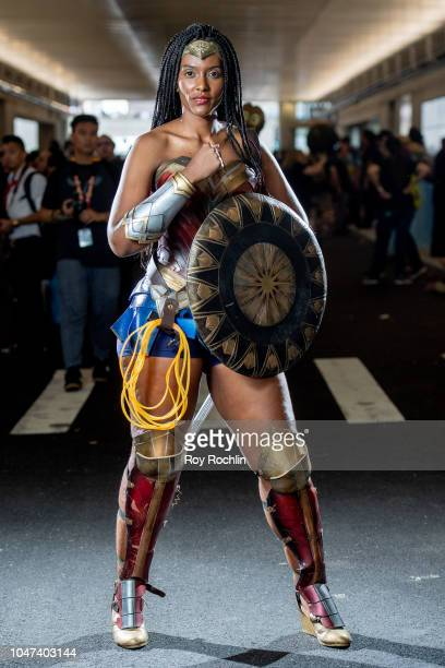 A fan cosplays as Wonder Woman form the DC Universe during the 2018 New York ComicCon at Javits Center on October 7 2018 in New York City