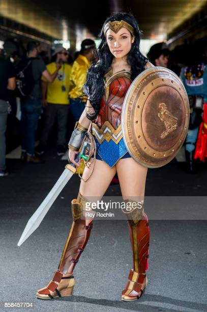 A fan cosplays as Wonder Woman from the DC universe during 2017 New York Comic Con Day 2 on October 6 2017 in New York City