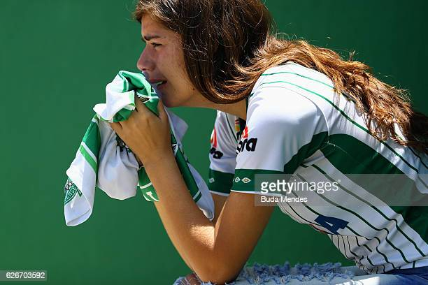 A fan cries while paying tribute to the players of Brazilian team Chapecoense Real at the club's Arena Conda stadium in Chapeco in the southern...