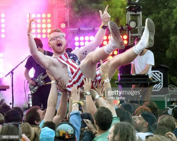 Fan crowdsurfs during Australian band Pond's set at Shaky Knees Music Festival at Centennial Olympic Park on May 14, 2017 in Atlanta, Georgia.