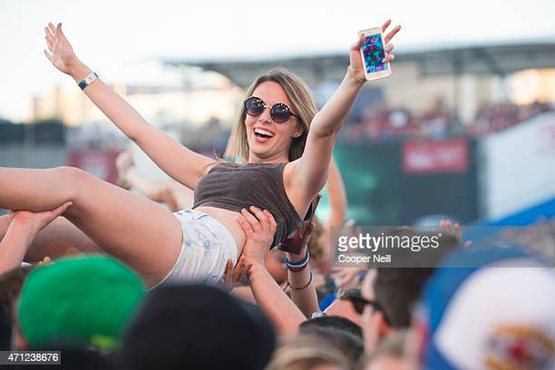 A fan crowdsurfs during Edgefest 2015 at Toyota Stadium on April 25 2015 in Dallas Texas