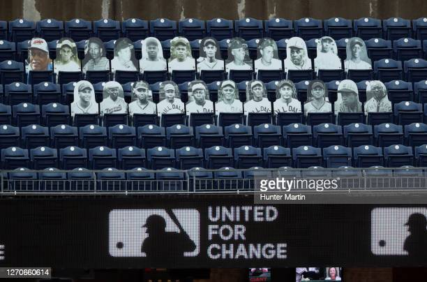 Fan cut-outs of African-American baseball players are seen in the left field seats during a game between the Philadelphia Phillies and the Atlanta...