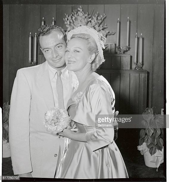 Fan dancer Sally Rand cuddles with her husband Los Angeles California building contractor Fred Lalla after they were married in Las Vegas late August...