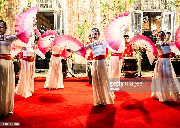 fan dancers rod fai market bangkok - chinese culture stock pictures, royalty-free photos & images