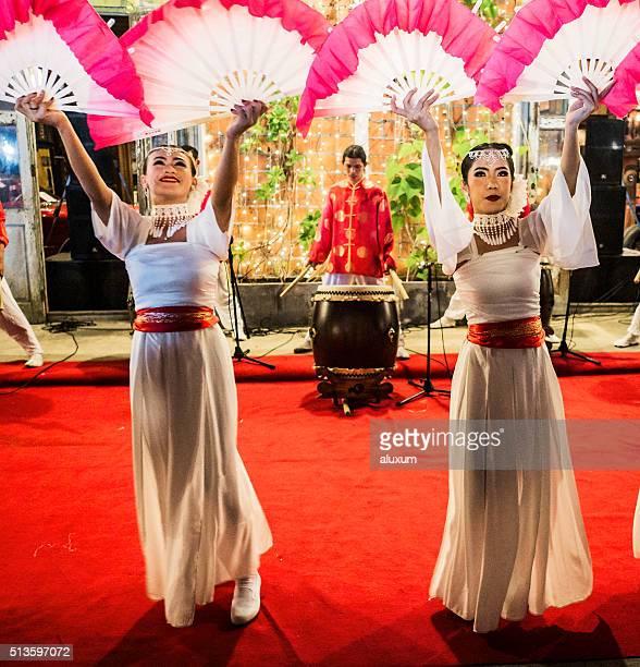 Fan dancers Rod Fai market Bangkok
