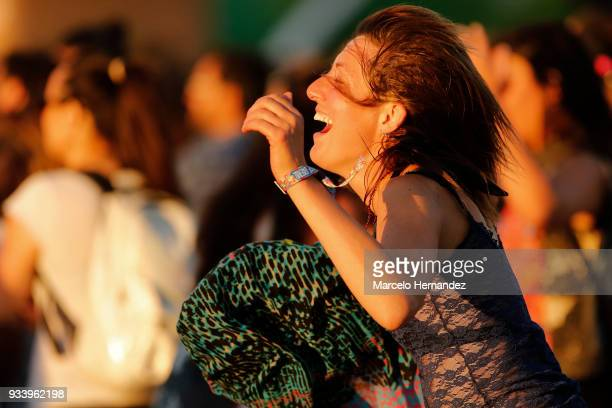 A fan dances during the first day of Lollapalooza Chile 2018 at Parque O'Higgins on March 16 2018 in Santiago Chile