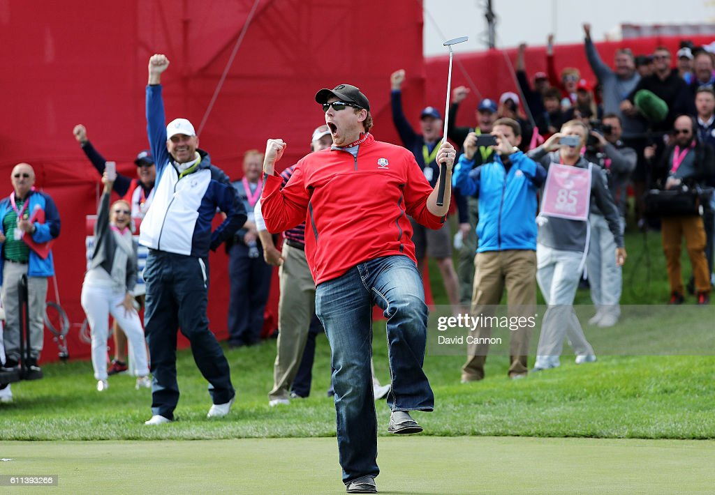 Fan David Johnson of North Dakota reacts after being pulled from the crowd and making a putt on the eighth green during practice prior to the 2016 Ryder Cup at Hazeltine National Golf Club on September 29, 2016 in Chaska, Minnesota.