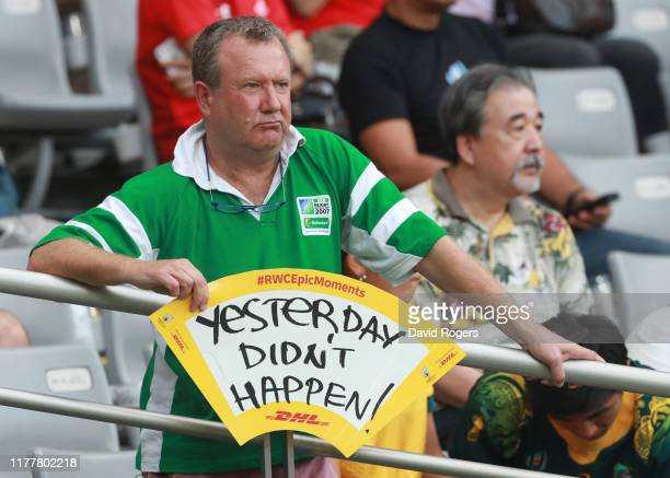 A fan displays a sign as he looks on prior to the Rugby World Cup 2019 Group D game between Australia and Wales at Tokyo Stadium on September 29 2019...