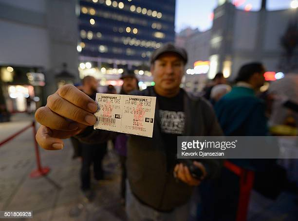 A fan displays his ticket for the opening night of Walt Disney Pictures and Lucasfilm's 'Star Wars The Force Awakens' at TCL Chinese Theatre on...
