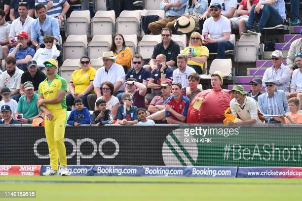 Fan dressed as a cricket ball holds a piece of sandpaper in the crowd and shouts to Australia's Marcus Stoinis as he fields during the 2019 Cricket...