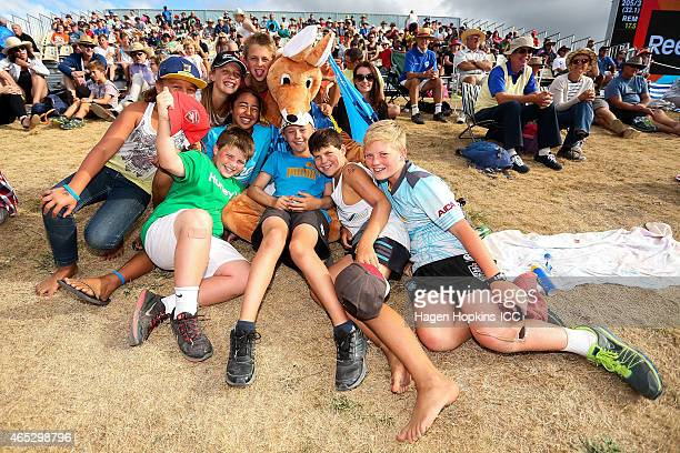 A fan dressed as a kangaroo poses with children during the 2015 ICC Cricket World Cup match between Bangladesh and Scotland at Saxton Field on March...