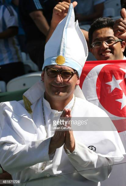 A fan dressed as a pope attends the 2014 FIFA World Cup Brazil Round of 16 match between Argentina and Switzerland at Arena de Sao Paulo on July 1...