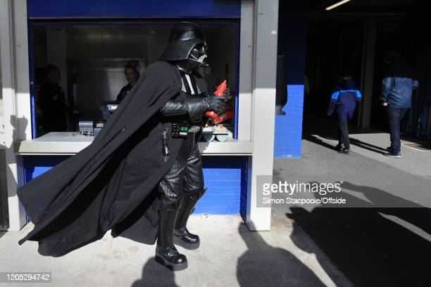 A fan dressed as Darth Vader holds a bottle of ketchup before the Premier League match between Everton FC and Manchester United at Goodison Park on...