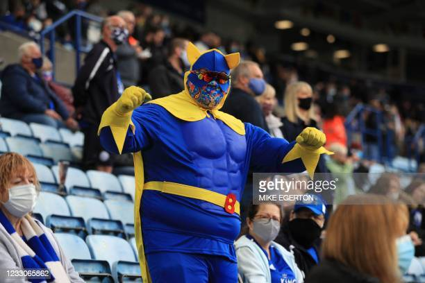 Fan dressed as fictional superhero Bananaman is seen in the crowd ahead of the English Premier League football match between Leicester City and...