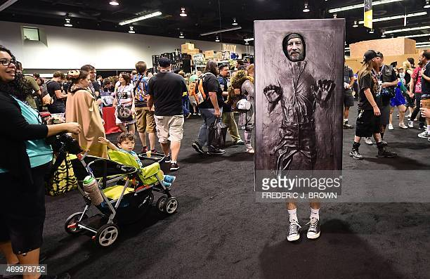 Fan dressed as Han Solo frozen in carbonite poses for a photo during the opening day of the 25th Star Wars Convention on April 16, 2015 in Anaheim,...