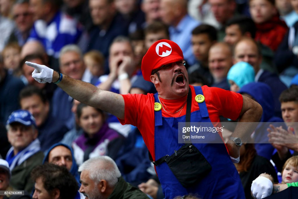 A fan dressed as Super Mario enjoys the atmosphere during the pre-season friendly match between Queens Park Rangers and AFC Bournemouth at Loftus Road on July 29, 2017 in London, England.