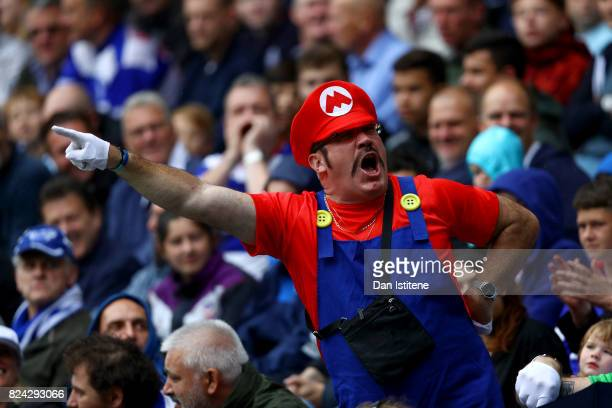 A fan dressed as Super Mario enjoys the atmosphere during the preseason friendly match between Queens Park Rangers and AFC Bournemouth at Loftus Road...