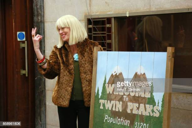 A fan dressed as the character Diane poses in front of the Welcome to Twin Peaks sign during the Twin Peaks UK Festival 2017 at Hornsey Town Hall...