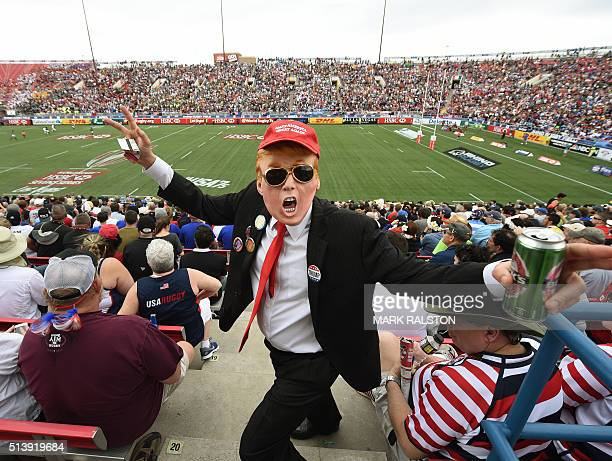 A fan dressed as US Republican presidential hopeful Donald Trump poses in the crowd during day two of the Men's 2016 USA Sevens Rugby Tournament...