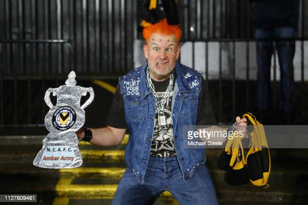 A fan dressed as Vyvyan from the Young Ones shows his support prior to the FA Cup Fourth Round Replay match between Newport County AFC and...
