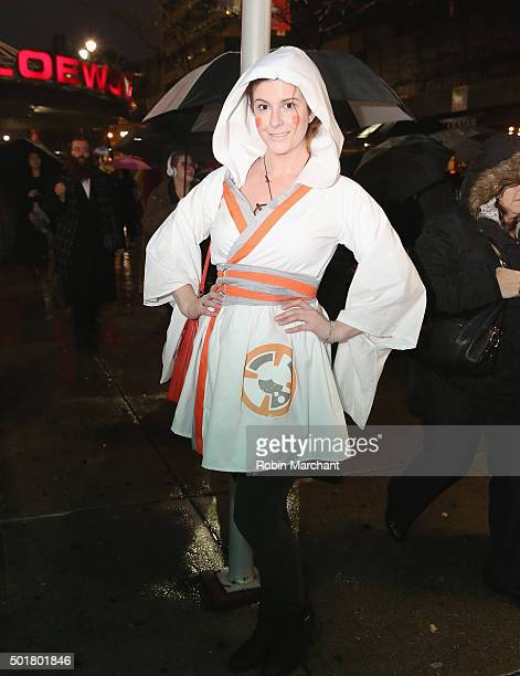 A fan dressed at BB8 poses for a photo while in line to Watch 'Star Wars The Force Awakens' at AMC Loews 34th Street 14 on December 17 2015 in New...