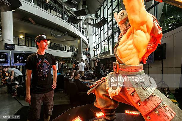 A fan dressed in limited edition DOTA 2 merchandise poses for a photo at The International DOTA 2 Champsionships at Key Arena on July 19 2014 in...