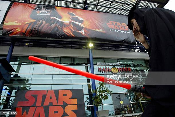 """Fan dressed up as a Jedi, queues at a cinema in Santiago, 18 May 2005, for the worldwide premier of """"Star Wars"""" final episode tonight. People dressed..."""