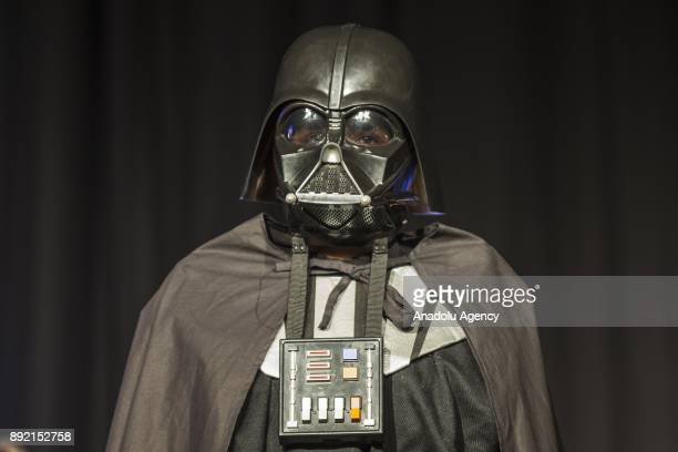 A fan dressed up as Darth Vader poses for a photo during a gathering for the latest of the Star Wars film series Star Wars The Last Jedi movie in...
