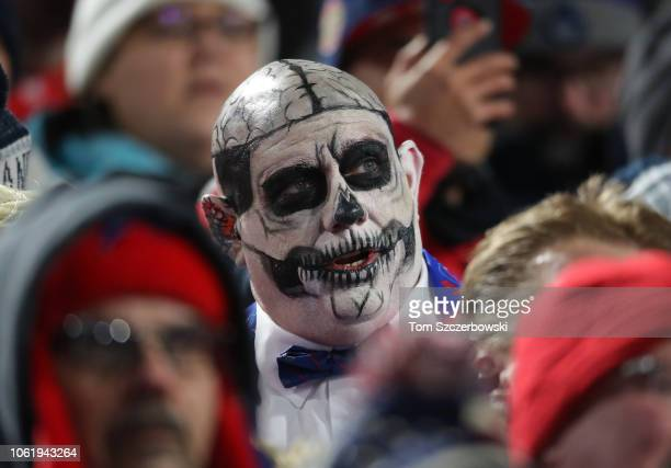 A fan dressed up as Uncle Fester from the Addams Family looks on during the Buffalo Bills NFL game against the New England Patriots at New Era Field...