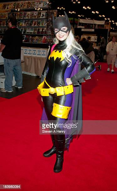 A fan dresses as the DC character Bat Girl at New York Comic Con 2013 at Jacob Javits Center on October 10 2013 in New York City