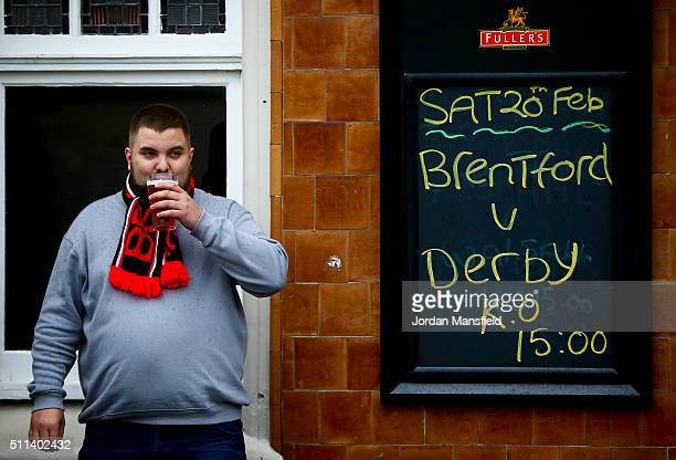 A fan drinks outside a pub ahead of the start of the Sky Bet Championship match between Brentford and Derby County at Griffin Park on February 20...