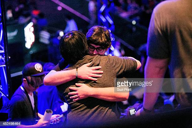A fan embraces William 'Blitz' Lee after meeting him in person for the first time at The International DOTA 2 Championships on July 21 2014 in...