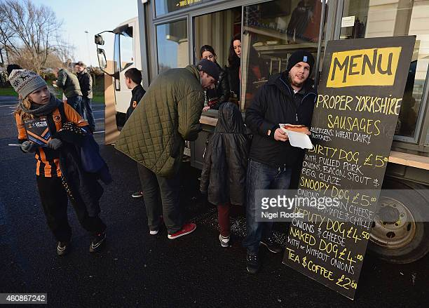 Fan enjoy a bite to eat prior to the Barclays Premier League match between Hull City and Leicester City at KC Stadium on December 28 2014 in Hull...