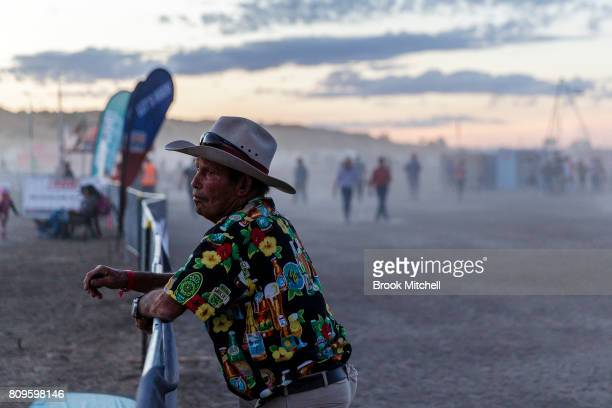 A fan enjoying the last night of the Big Red Bash 2017 on July 6 2017 in Birdsville Australia