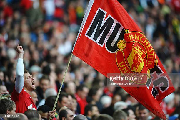 A fan enjoys the atmosphere ahead of the UEFA Champions League final between FC Barcelona and Manchester United FC at Wembley Stadium on May 28 2011...
