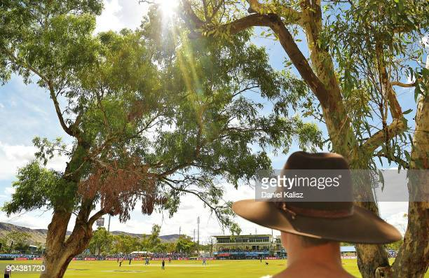 A fan enjoys the atmosphere and shade during the Big Bash League match between the Adelaide Strikers and the Perth Scorchers at Traeger Park on...