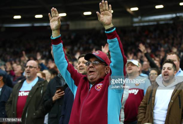 A fan enjoys the atmosphere during the Premier League match between West Ham United and Crystal Palace at London Stadium on October 05 2019 in London...